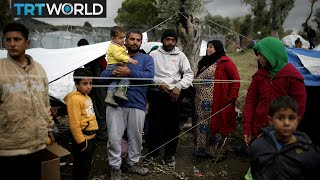 Turkish aid groups work to keep refugees warm