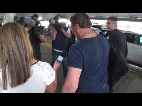 AFL legend Mark 'Bomber' Thompson arrives in Los Angeles lax days after arrest