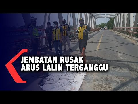 jembatan berlubang arus lalu lintas terganggu