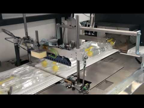 Shrink wrapping of oil bottles in double packs