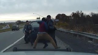 Dashcam video shows moment of near-fatal police shootout