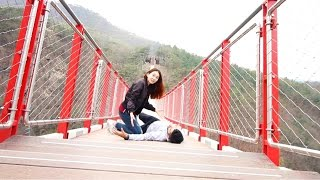 In the most dangerous bridge in the world! he Fainted