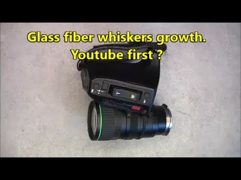 Glass fiber whiskers on a broadcast zoom lens