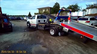 How AAA load a car on a flatbed tow truck