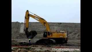 Deere 800C loading 740's (clip 1)