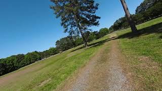 DJI FPV Drone flying in the park near football field