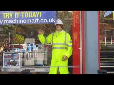 mannequin-man performming as a Living Mannequin: Mechanical waving mannequin man at the 2014 London Marathon at the Docklands Machine Mart Store  for Machine Mart on 13/04/2014