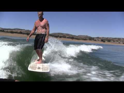 LT wakesurfing with his walden longboard