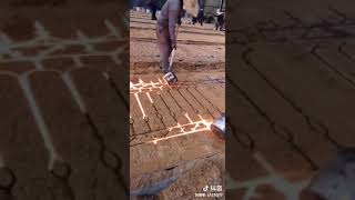 Chinese iron workers making fences