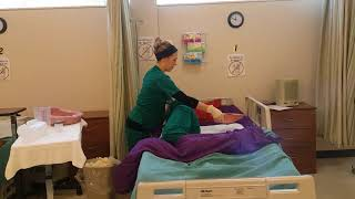 Assisting a Patient On and Off the Bedpan (Fracture Pan)