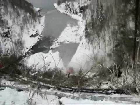 Tow Truck Falls Off Cliff On Snowy Road.