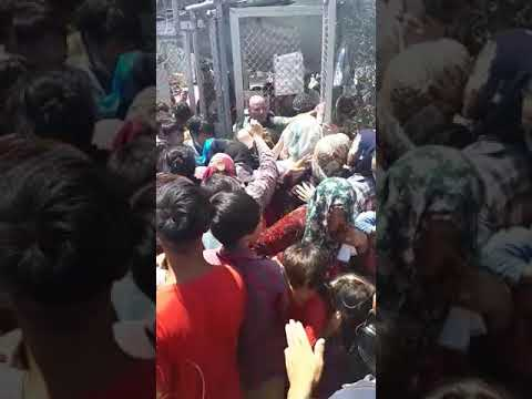 Queuing to get tested for Covid-19 Moria refugee camp