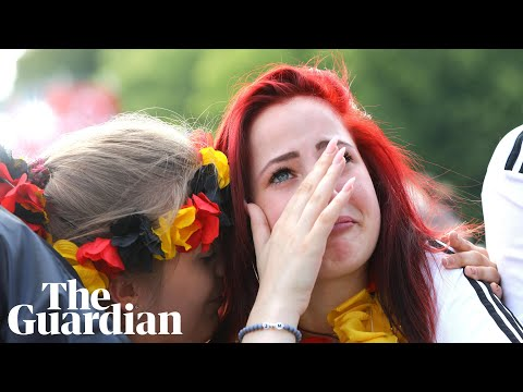 German fans react as champions are knocked out of World Cup