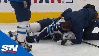 Winnipeg Jets forward Mark Scheifele collided awkwardly with Calgary Flames forward Matthew Tkachuk and was forced to leave the game with an injury.  ---------------------------------------------- 
