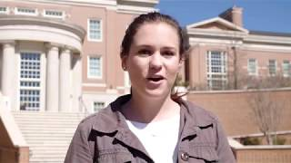 Shelby Hall stands outside while being interviewed.