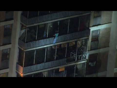 Video from the WPVI-TV helicopter in Philadelphia shows a man scaling down the side of a high rise building during a fire on Thursday night. (July 19)