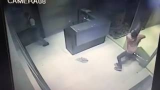 A heavy glass ceiling collapses, almost hitting young man.