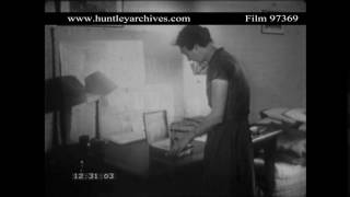 Woman turns on Battery-Operated Wireless, 1950's.  Archive film 97369