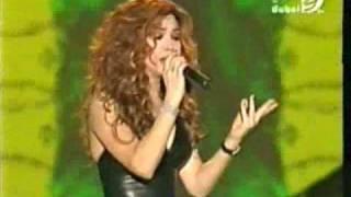 تحميل اغاني نوال الزغبي تغني مساء الخير في ليالي دبي 2004 MP3