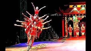 Circus. The show of girl gymnasts on bicycles.
