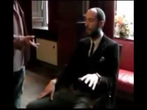 Hand Levitation Hypnosis - John performing hand levitation on a reporter