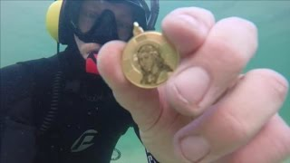 TREASURE FOUND IN THE OCEAN! Guns, Gold, Silver, Cell Phone & Coins Metal Detecting Underwater! - Video Youtube