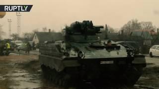 Dozens of German tanks arrive in Lithuania for NATO deployment