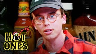 Hot Ones - Logic Solves a Rubik's Cube While Eating Spicy Wings