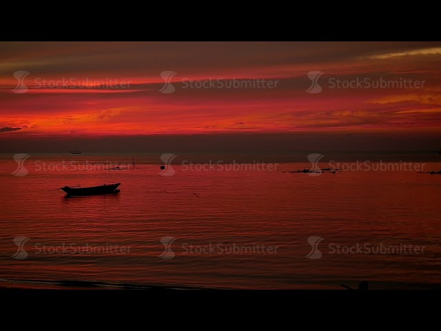Amazing Colors of tropical sunset with fishing ship. slow motion. Koh Phangan, Thailand. 1920x1080