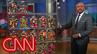 CNN anchor counts Trump's false claims using gumballs