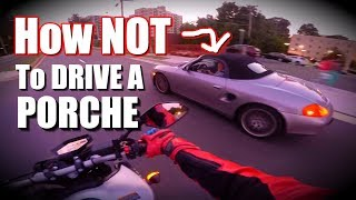 PORCHE DRIVER RAGES AT BIKER AFTER CUTTING THEM OFF...