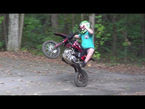 Nathan on his pitbike and dirtbike We fixed the ssr140 and talking yz125, much more fun..