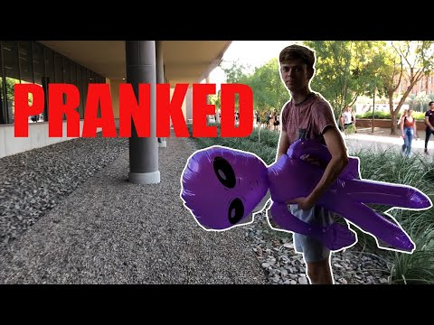 Pranking ASU Students by carrying a purple Alien and ignoring them