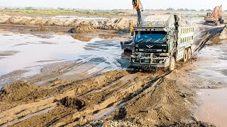 Best UD Nissan truck dumper crossing huge muds with full excalator .May 13, 2019