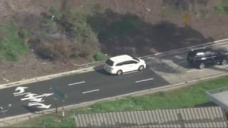 Police chase possibly armed suspect through San Fernando Valley