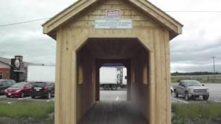 walking through smallest covered bridge at 24 feet long.