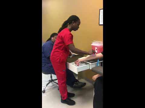 Phlebotomy Technician Student Drawing Blood