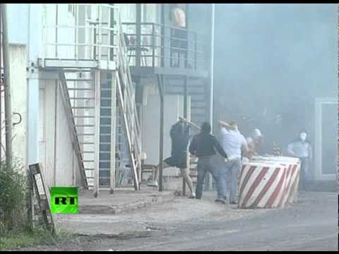 Dramatic video: Serbs attack, set Kosovo border post on fire