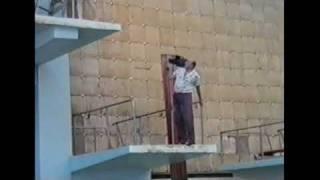 Cameraman falls off high dive board