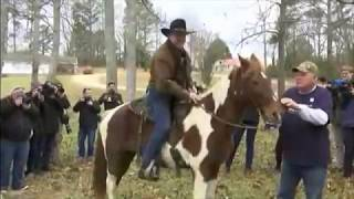 Roy Moore goes cowboy! Rides horse to vote in Alabama election