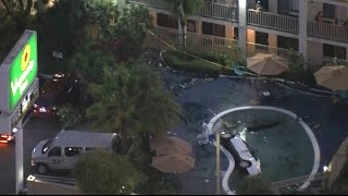SUV IN POOL:  Raw video of SUV crash into pool at Los Angeles Motel