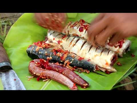 Survival skills: Fried big fish on clay for food at river flow - Cooking big fish eating delicious