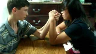 Girl beats boy in arm wrestling Super funny hilarious!!!!