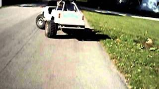 My Carter brothers Grave Digger go kart with the mini monster jeep body on  it tearin down the street