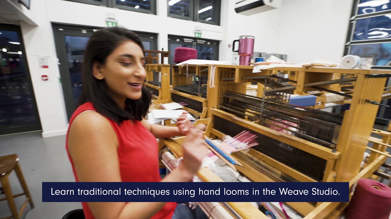 a student using a hand loom in the Weave Studio
