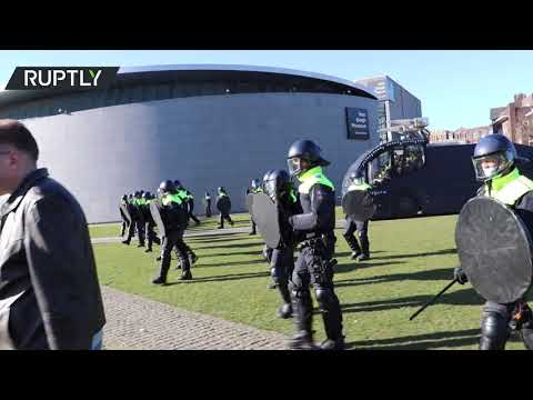 COVID skeptics' rally dispersed by police in Amsterdam