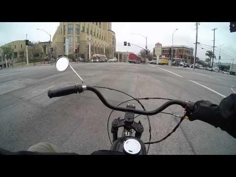 Motorized Bike Lane Spliting through traffic In Downtown LA.