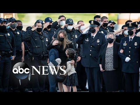 Officer Evans honored, the Kumbh Mela and BLM protests: World in Photos, April 14