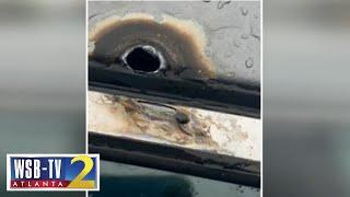 Lightning strike leave holes in metro Atlanta woman's car