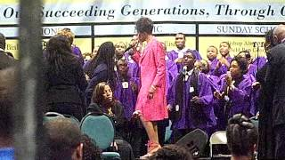 Judith McAlister singing with the COGIC choir at AIMS 2012